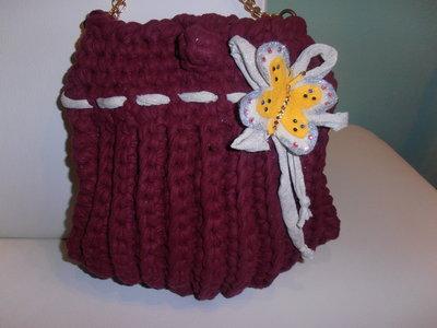 Particolare borsa in fettuccia  di cotone bordeaux