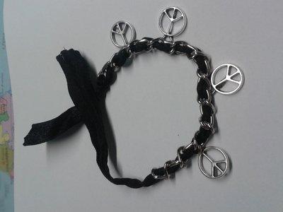 Bracciale con catena nastro simboli della pace o nota musicale