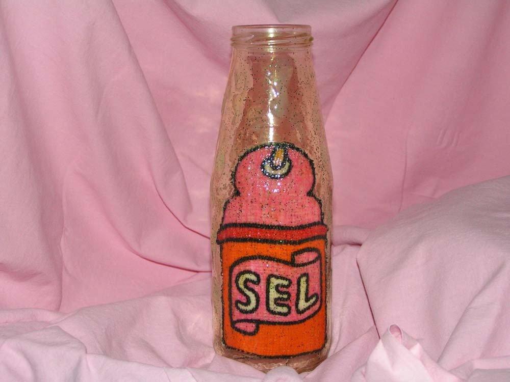 bottiglia con decoro in stoffa