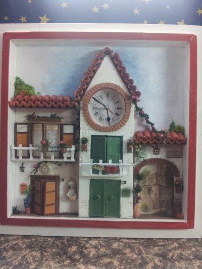 quadro a rilievo con orologio