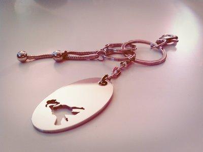 Portachiavi ovale Abrazo in acciaio Adornos