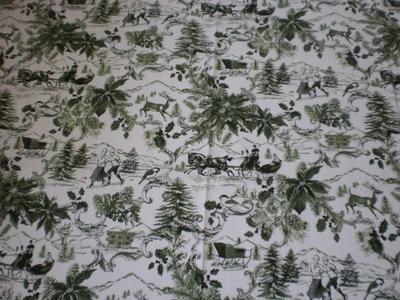 Stoffa natalizia bianca con slitte verdi