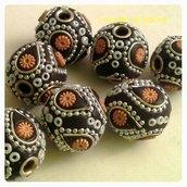 perle tonde ricoperte di perline