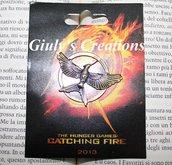Spilla di Mockingjay - Il Canto della Rivolta il 3° ed ultimo capitolo della saga Hunger Games
