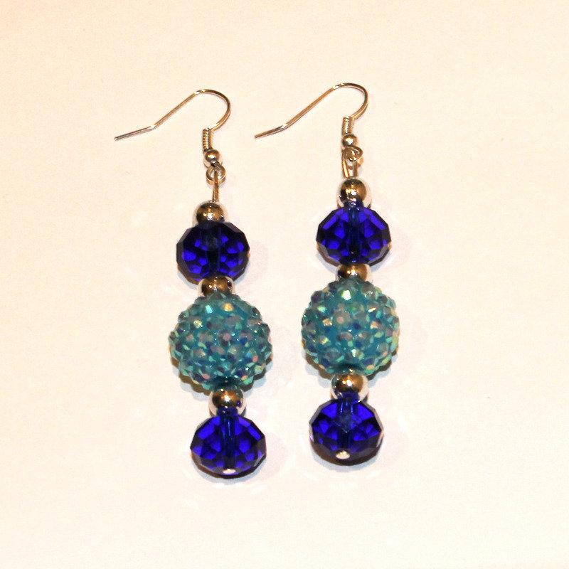 Orecchini lunghi con pietre blu
