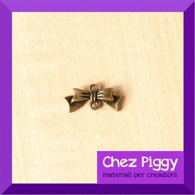 1 connettore a forma di fiocco - bronzo