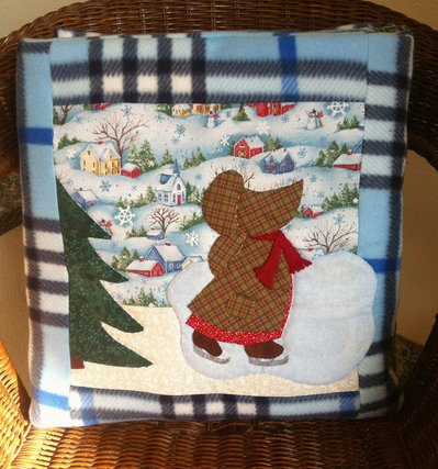 cuscino quillow bambina che pattina  - un cuscino con dentro un plaid