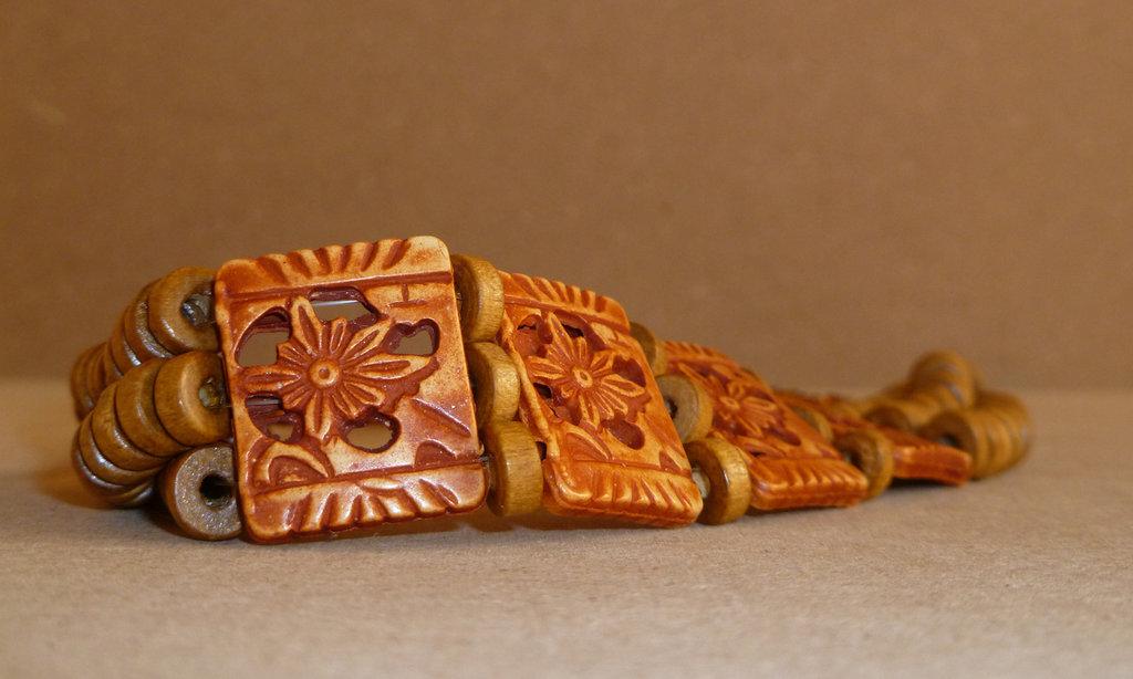 Strozzacollo in legno