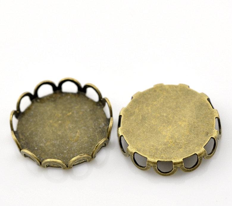 base cammeo, Cabochon , decorazione color bronzo adatto a cammeo di 15 mmscontato solo x poco