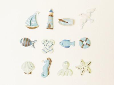 Set di 24 bomboniere in feltro celeste con miniature a tema marino - marittimo: la bomboniera per il battesimo, la comunione o la cresima in spiaggia del vostro bambino!
