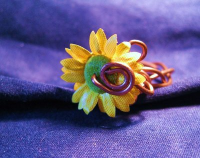 Copper ring with a small sunflower