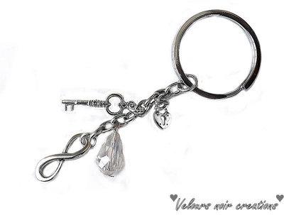 portachiavi unisex simbolo infinito lucchetto chiave