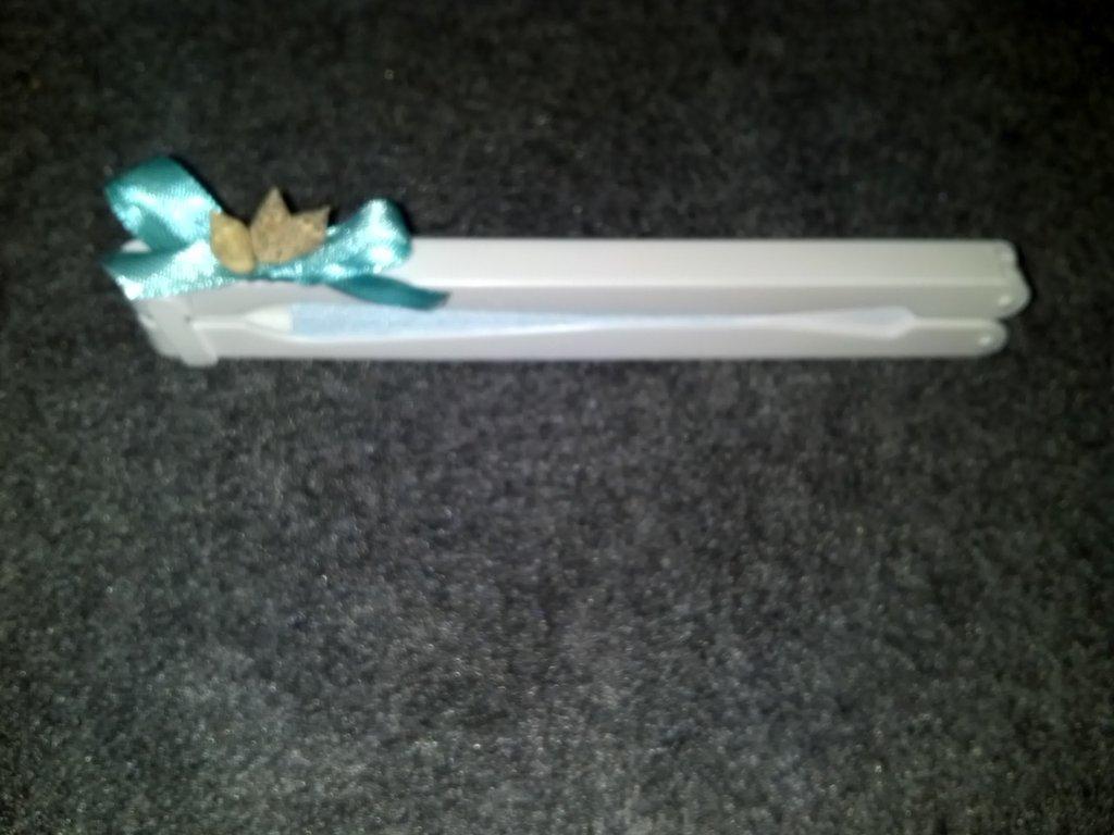 ventagli di carta e plastica con conchiglie