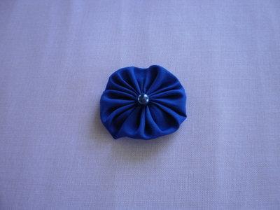 Yo-yo circolare (diametro 6 cm) di stoffa color azzurro