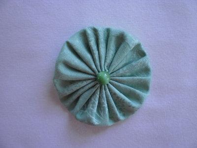 Yo-yo circolare (diametro 6 cm) di stoffa color verde chiaro
