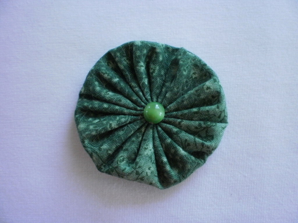 Yo-yo circolare (diametro 6 cm) di stoffa color verde