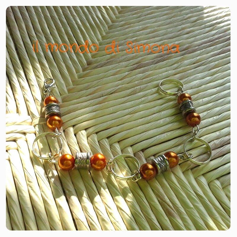 bracciale con perle color ambra e cerchi color argento