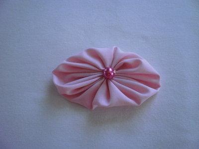 Yo-yo ovale di stoffa color rosa chiaro