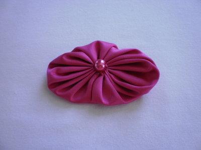 Yo-yo ovale di stoffa color fucsia