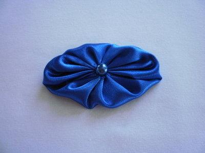 Yo-yo ovale di stoffa color azzurro lucido
