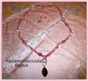 parure collana e orecchini rosa/fucsia con pendente