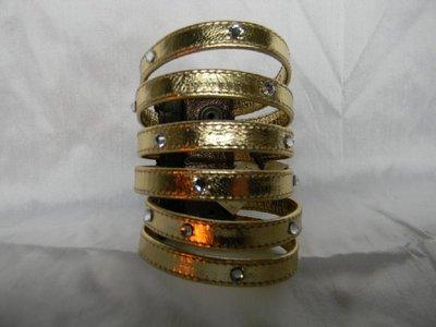 Bracciale 6 fascette eco pelle color oro con swarovski.Larghezza cm.6,polso cm.17