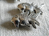 Pesciolini in metallo