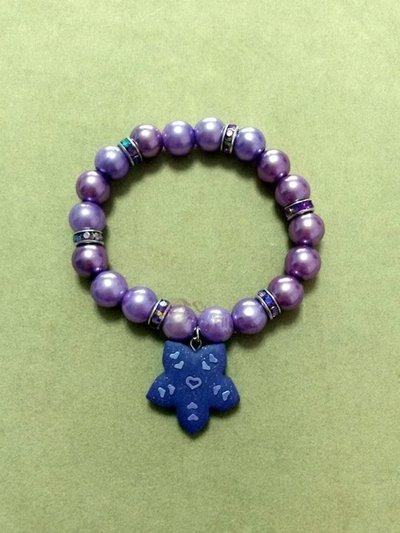 Braccialetto elastico con perle e fiore fimo