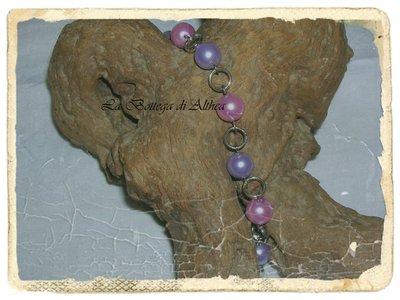 Bracciale in perle di vetro ricoperte rosa e viola