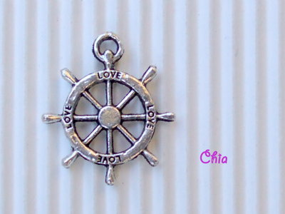 6 charms timone 23x20mm vend.