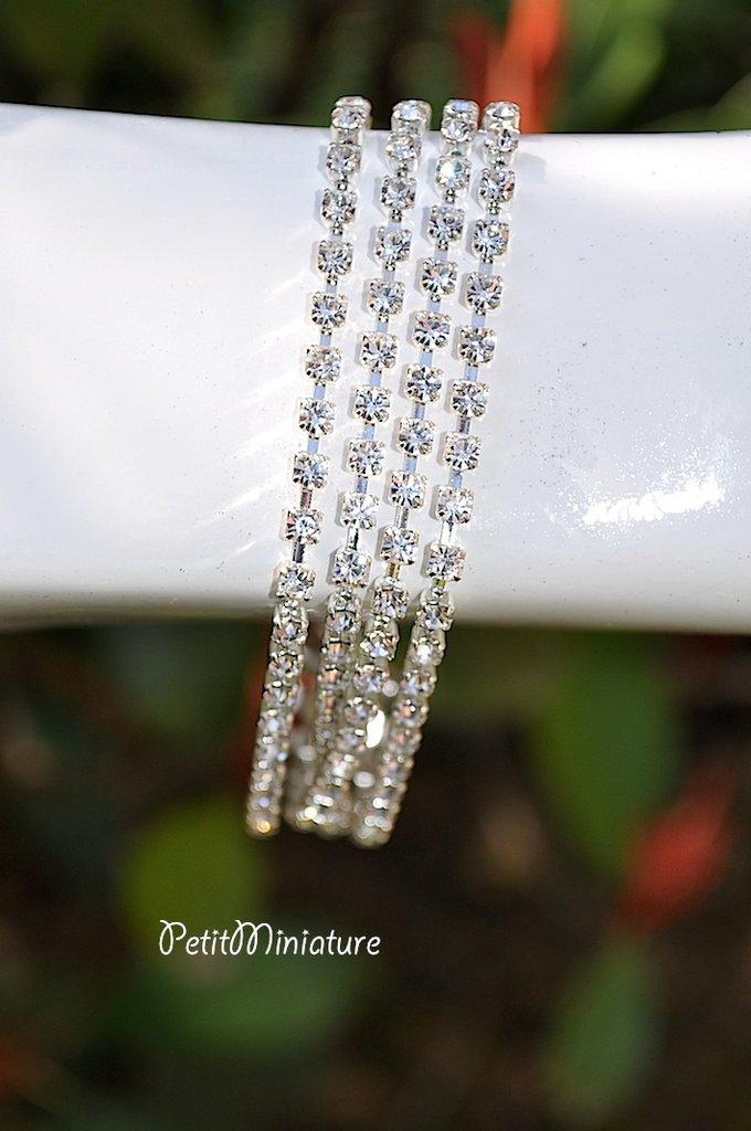 Bracciale in metallo argento,catena swarovski originali e luccicanti.made in italy.