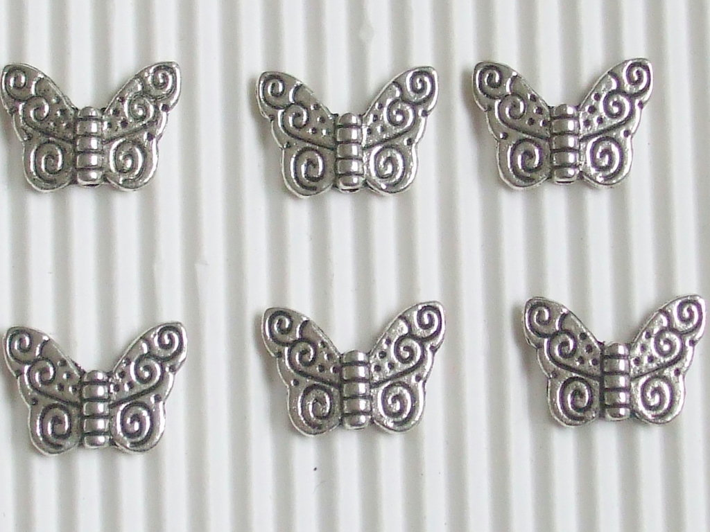 6 charms farfalline lavorate 15x10mm