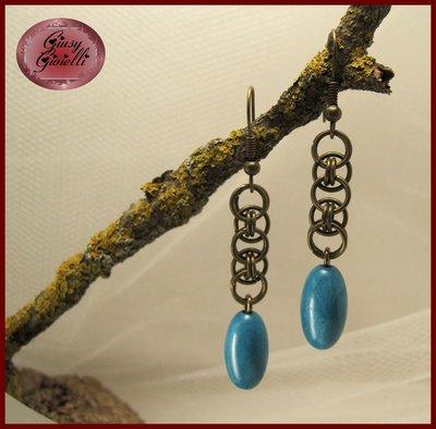 Orecchini color bronzo con perla turchese
