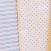 Tessuto di cotone bianco a pois azzurri