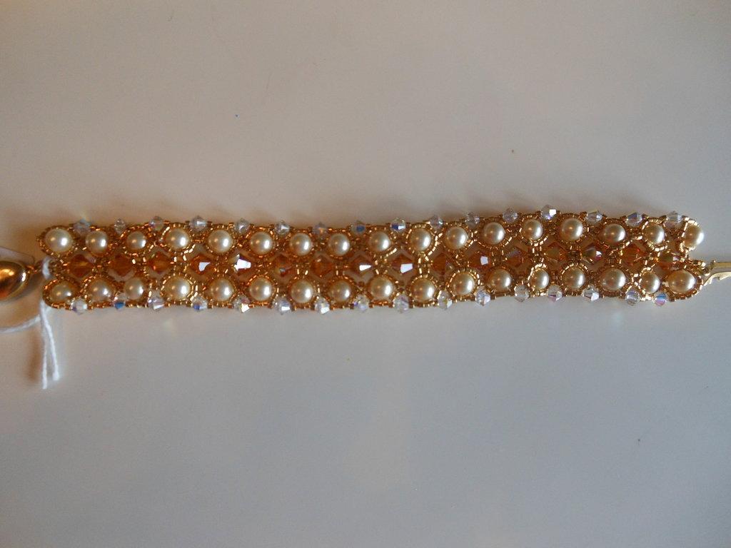 Braccialetto perle e cristalli swarovski 6 mm.