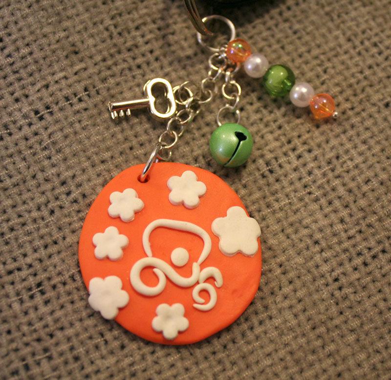 auto nuova portachiavi My car arancione e bianco con campanellino e perline