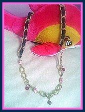 catena dorata con pietre tipo maiolica
