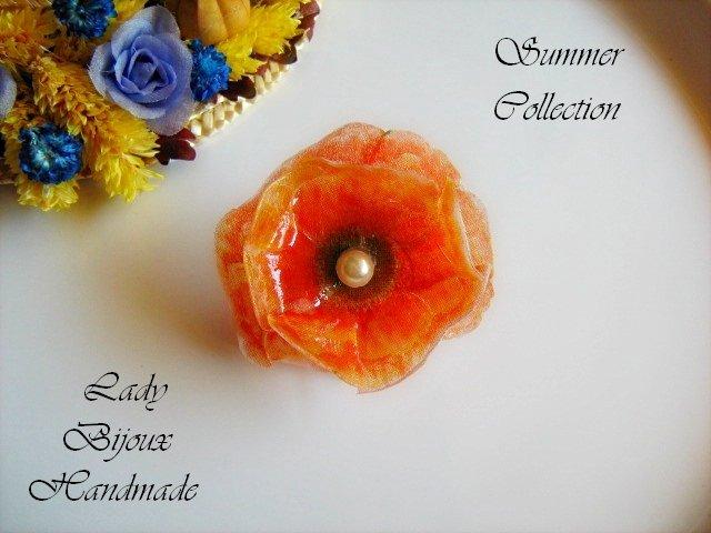 Anello regolabile con fiore rosso fatto in Sospeso Trasparente