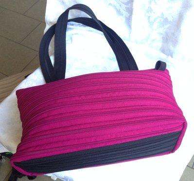 Borsa zip a bauletto bicolore