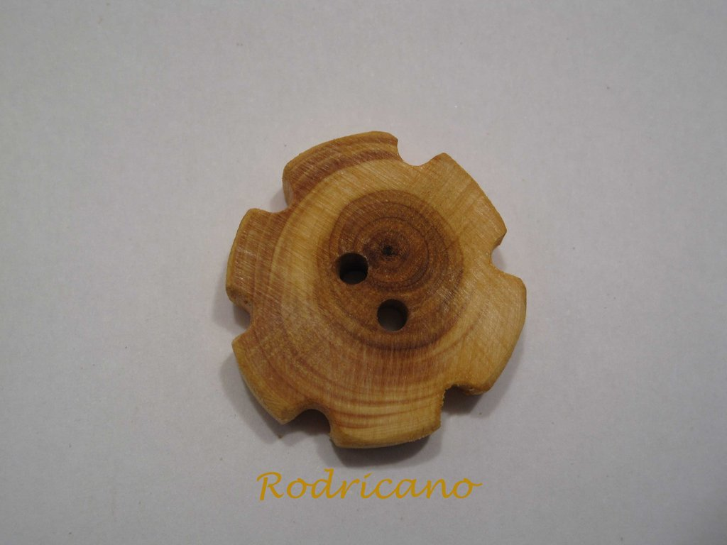 Botón flor tejo