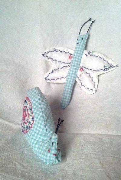 farfalla e lumaca di stoffa