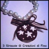 Braccialetto  con perle e pan di stelle