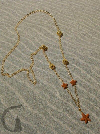 Collana con stella marina in pasta fimo impreziosita con cristalli swarovsky e perle in filigrana- Stelle marine