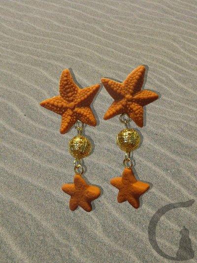 Orecchini con ciondoli in pasta fimo, swarovsky e perle in filigrana - Stelle marine