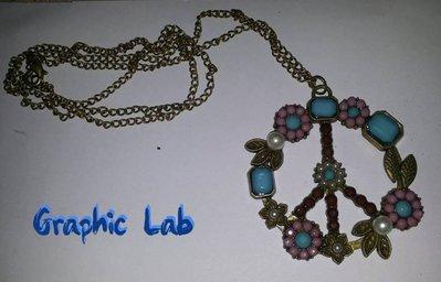 Collana in bronzo con grande simbolo della pace contornato da fiori colorati