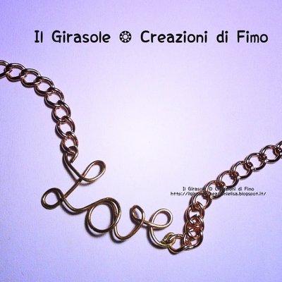 """Braccialetto in catena in metallo con scritta wire """"love"""""""