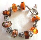 Bracciale con perle in vetro,metallo,acrilico e strass con base argentata