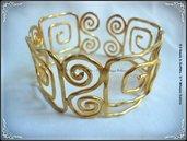 Bracciale in alluminio modellabile dorato antichizzato da avambraccio o polpaccio.