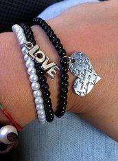 Bracciale triplo di perline bianche e nere fatto a mano