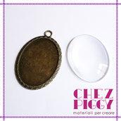 Ciondolo ovale bronzo + vetrino trasparente 3 x 4 cm